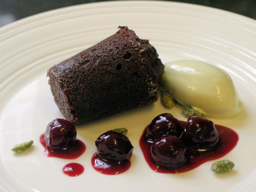 Chocolate fondant with cherry compote and pistachio ice cream