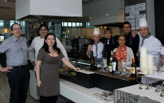 Luca Mannori and wife, with restaurant team. Monica Meschini in front