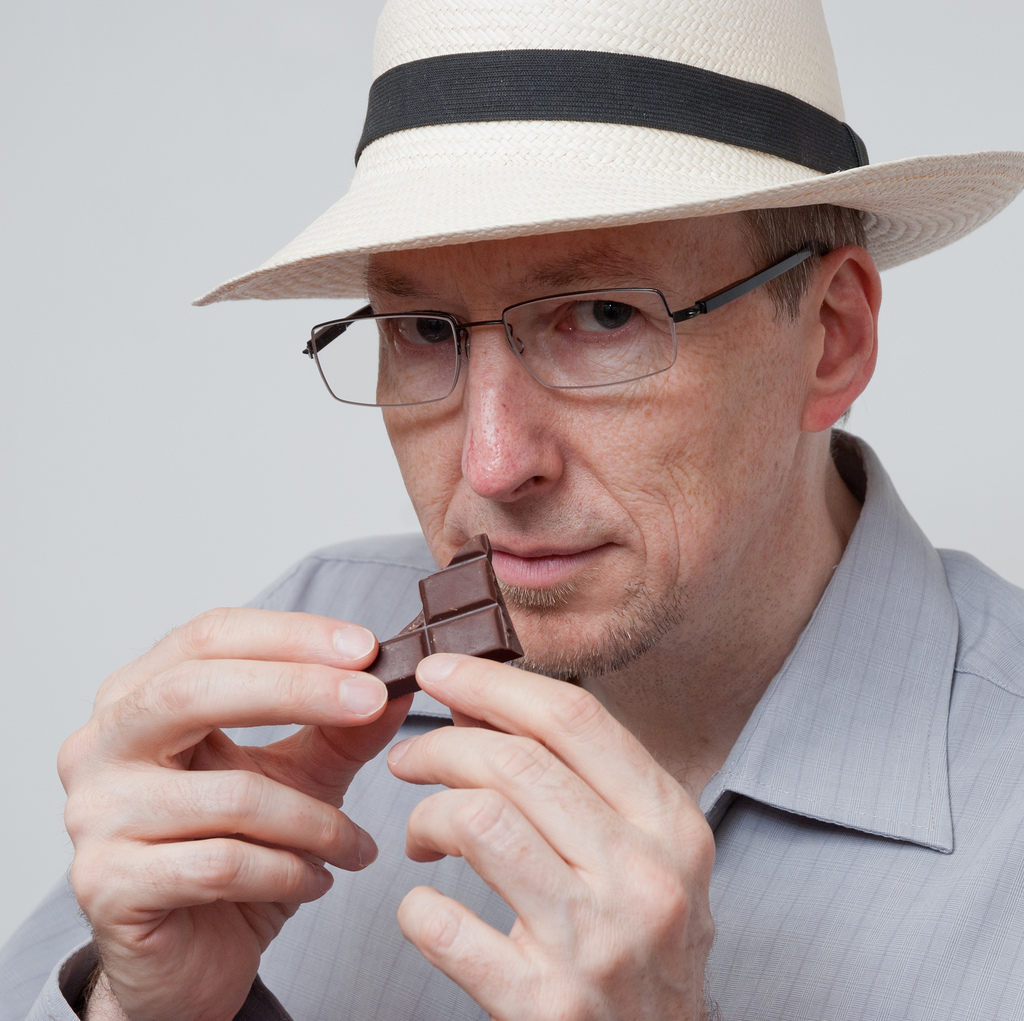 Martin Christy profile photo – sniffing chocolate with hat